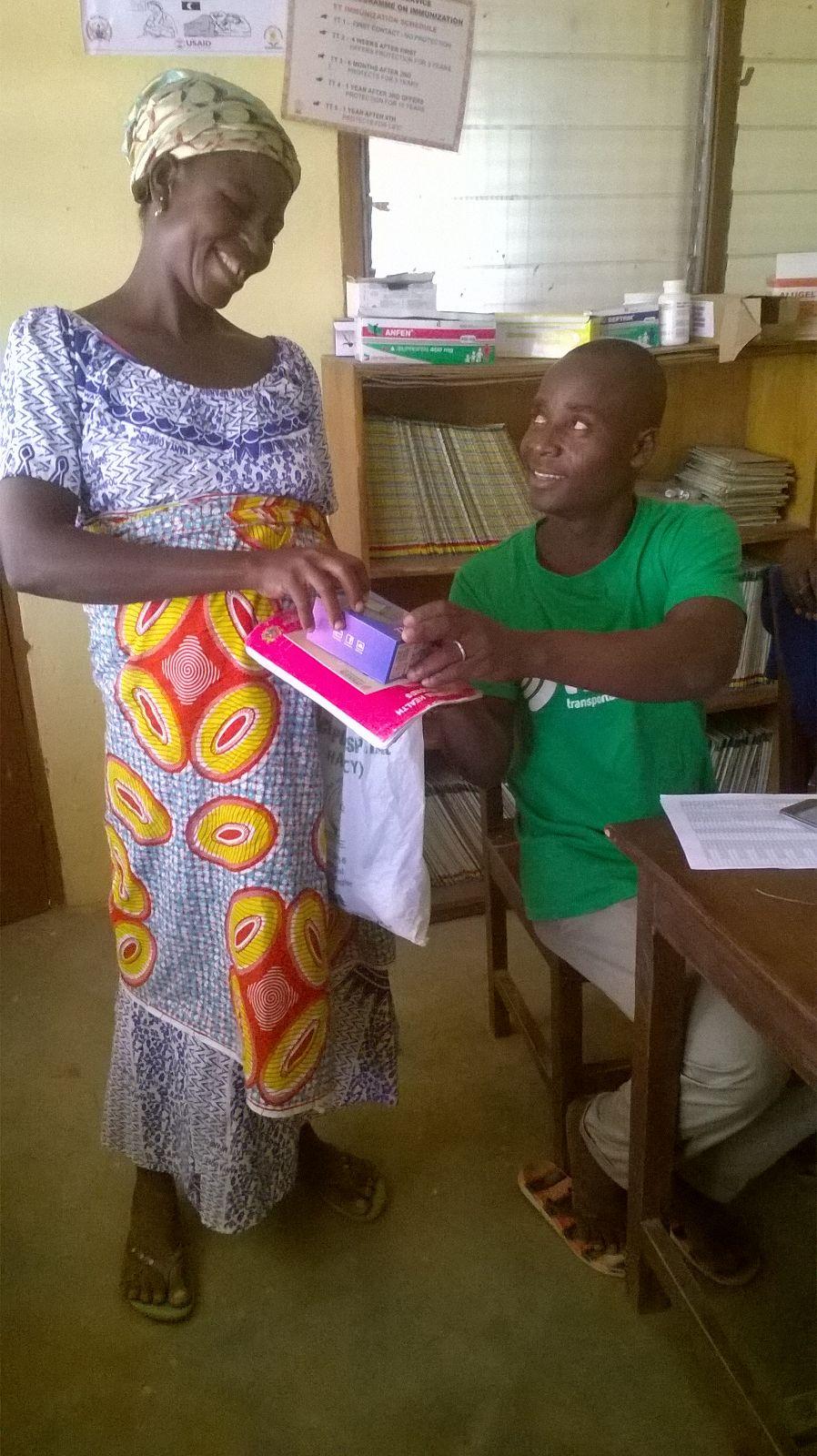 MAZA driver-Ubabe-helping to subscribe pregnant women to MAZA's service in Garinkuka